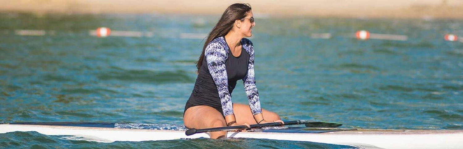 Woman sitting on a paddleboard