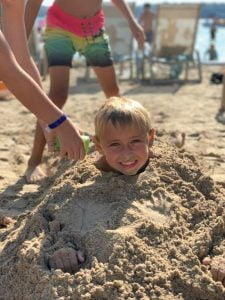 Child in the sand at Elkhart Lake