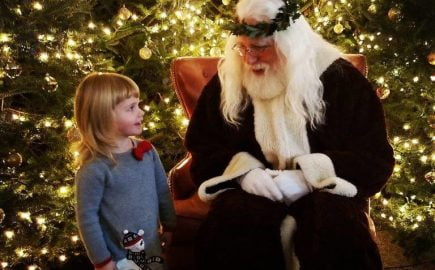 Santa and a little girl at Old World Christmas Market