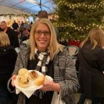 Guest Holding Food at the Old World Christmas Market