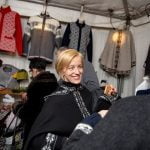 Woman Selling Sweaters at Old World Christmas Market